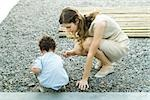 Mother and toddler crouching on gravel, looking at rocks Stock Photo - Premium Royalty-Free, Artist: Thomas Kokta, Code: 695-03379626