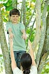 Boy in tree, mother reaching up to help him down Stock Photo - Premium Royalty-Free, Artist: Cusp and Flirt, Code: 695-03379892