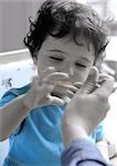 Person feeding young child. Stock Photo - Premium Royalty-Free, Artist: Mark Leibowitz, Code: 695-03381005