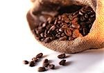 Coffee beans spilling out of burlap sack Stock Photo - Premium Royalty-Free, Artist: Flowerphotos, Code: 695-03381496