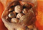 Walnuts in burlap sack, one golden Stock Photo - Premium Royalty-Free, Artist: Cusp and Flirt, Code: 695-03381503