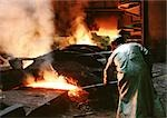 Man bending forward, working in blast furnace, rear view Stock Photo - Premium Royalty-Free, Artist: Arcaid, Code: 695-03381531