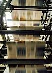 Printed newspaper on printing press, blurred motion Stock Photo - Premium Royalty-Free, Artist: Daryl Benson, Code: 695-03381563