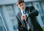 Businessman looking at watch, portrait Stock Photo - Premium Royalty-Free, Artist: Eyecandy Pro, Code: 695-03381595