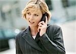 Businesswoman using cell phone, portrait Stock Photo - Premium Royalty-Free, Artist: Bob Devan, Code: 695-03381671