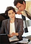 Businessman and businesswoman looking at laptop computer Stock Photo - Premium Royalty-Free, Artist: Sheltered Images, Code: 695-03381708