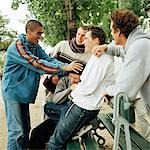 Young people grouped around park bench Stock Photo - Premium Royalty-Free, Artist: F1Online, Code: 695-03382259