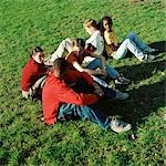 Young people sitting on grass, high angle view Stock Photo - Premium Royalty-Free, Artist: Elizabeth Knox, Code: 695-03382478
