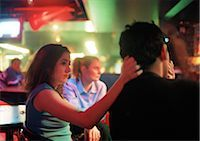 Young man and young woman sitting in bar Stock Photo - Premium Royalty-Freenull, Code: 695-03382862