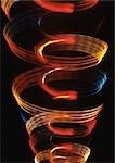 Spiraling light effect, one within the other, oranges, reds and blues. Stock Photo - Premium Royalty-Free, Artist: IIC, Code: 695-03382945
