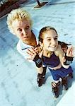 Mature woman and young girl on in-line skates, making faces at camera, high angle view Stock Photo - Premium Royalty-Free, Artist: Harald Vorsteher, Code: 695-03383701