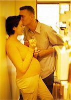 Man kissing pregnant woman's forehead, yellow tone Stock Photo - Premium Royalty-Freenull, Code: 695-03384043