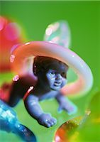 Condom on plastic baby doll's head Stock Photo - Premium Royalty-Freenull, Code: 695-03384285