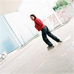 Young woman wearing inline skates, profile Stock Photo - Premium Royalty-Free, Artist: Peter Griffith, Code: 695-03384704