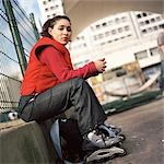 Young woman wearing inline skates, portrait Stock Photo - Premium Royalty-Free, Artist: Hiep Vu, Code: 695-03384707