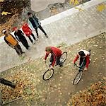 Young people, two riding bikes, elevated view Stock Photo - Premium Royalty-Free, Artist: F1Online, Code: 695-03384737