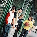 Young people, one young man holding basketball Stock Photo - Premium Royalty-Free, Artist: F1Online, Code: 695-03384744