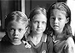 Three girls side by side, portrait, b&w Stock Photo - Premium Royalty-Free, Artist: F1Online, Code: 695-03385109