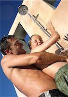 preteen shower pic - Man holding child in shower. Stock Photo - Premium Royalty-Freenull, Code: 695-03385136