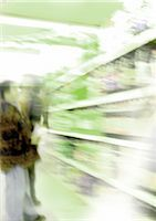People looking at shelves in grocery store, blurred Stock Photo - Premium Royalty-Freenull, Code: 695-03385285