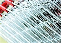 empty shopping cart - Shopping carts, extreme close-up Stock Photo - Premium Royalty-Freenull, Code: 695-03385297