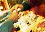 Hands exchanging money in market, blurred Stock Photo - Premium Royalty-Free, Artist: Glowimages, Code: 695-03385299