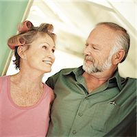 Mature couple looking at each other, woman with rollers in hair, portrait Stock Photo - Premium Royalty-Freenull, Code: 695-03385426