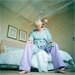 Mature man massaging woman, low angle view Stock Photo - Premium Royalty-Freenull, Code: 695-03385979