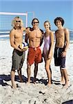 Four young people on beach with volleyball, smiling into camera. Stock Photo - Premium Royalty-Free, Artist: F1Online, Code: 695-03386168