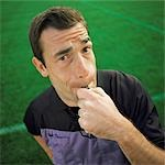 Referee blowing whistle, looking into camera, portrait. Stock Photo - Premium Royalty-Free, Artist: Photocuisine, Code: 695-03386384
