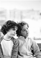 Two children side by side, b&w Stock Photo - Premium Royalty-Freenull, Code: 695-03386763