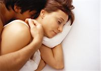 Man and woman in bed Stock Photo - Premium Royalty-Freenull, Code: 695-03386858