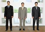 Three businessmen standing in a line Stock Photo - Premium Royalty-Free, Artist: Photocuisine, Code: 695-03387257