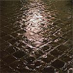 Light reflected onto cobbles, night Stock Photo - Premium Royalty-Freenull, Code: 695-03387305