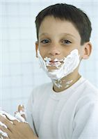 Boy with shaving cream on face and hands Stock Photo - Premium Royalty-Freenull, Code: 695-03388114