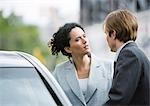 Businesswoman and man speaking next to car Stock Photo - Premium Royalty-Freenull, Code: 695-03388377