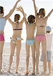 Group of kids waving on beach, rear view Stock Photo - Premium Royalty-Free, Artist: Cultura RM, Code: 695-03388662