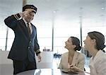 Airline pilot saluting two female travelers Stock Photo - Premium Royalty-Free, Artist: Scanpix Creative         , Code: 695-03388699