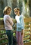 Two girls leaning against wooden fence Stock Photo - Premium Royalty-Free, Artist: Minden Pictures, Code: 695-03388801