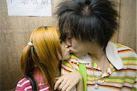 Teenage couple kissing Stock Photo - Premium Royalty-Freenull, Code: 695-03388895
