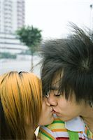 Teenage couple kissing in urban setting Stock Photo - Premium Royalty-Freenull, Code: 695-03388899