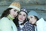 Young friends wearing winter clothing, portrait