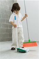 Little boy sweeping the floor Stock Photo - Premium Royalty-Freenull, Code: 695-03389973