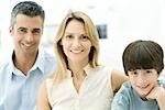 Parents and son smiling at camera, portrait Stock Photo - Premium Royalty-Freenull, Code: 695-03390255