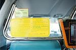 Notice in Chinese taxi Stock Photo - Premium Royalty-Free, Artist: Raimund Linke            , Code: 696-03394912