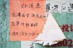 Handwritten Chinese flyers on wall Stock Photo - Premium Royalty-Freenull, Code: 696-03394920