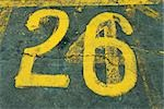 Number 26 painted on asphalt Stock Photo - Premium Royalty-Free, Artist: Transtock, Code: 696-03395069