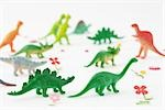 Plastic dinosaurs surrounded by fake flowers Stock Photo - Premium Royalty-Free, Artist: Sheltered Images, Code: 696-03395947