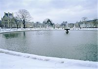 France, Paris, fountain in Tuileries Garden with snow Stock Photo - Premium Royalty-Freenull, Code: 696-03396412