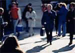 People walking on sidewalk, defocused Stock Photo - Premium Royalty-Freenull, Code: 696-03396990